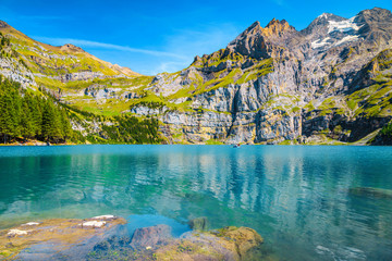 Wall Mural - Gorgeous alpine lake with high mountains and glaciers, Oeschinensee, Switzerland