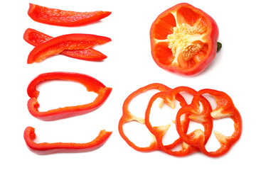 cut slices of red sweet bell pepper isolated on white background top view Fototapete