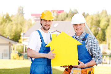 Workers with house model symbol