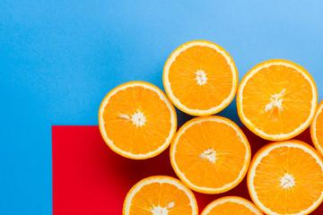 Cut halves of juicy orange on multicolored background. Orange fruit, citrus minimal concept....
