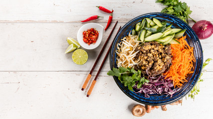Top view composition of vietnamese food in bowl