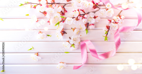 Wall mural Easter Spring Blossom on white wooden plank background. Easter Apricot flowers on wood border art design. Pink blooming tree on wood