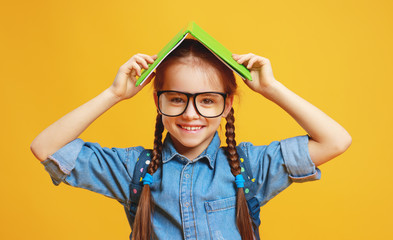 funny child school girl girl on yellow background