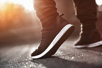Close up of man sneakers on street