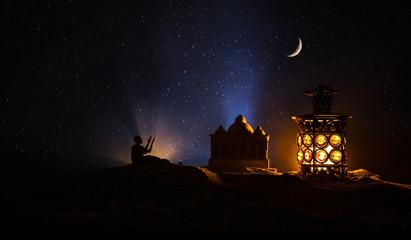 Ornamental Arabic lantern with burning candle glowing at night. Festive greeting card, invitation for Muslim holy month Ramadan Kareem. Wall mural