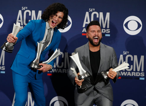54th Academy of Country Music Awards – Photo Room – Las Vegas, Nevada, U.S., April 7, 2019 – Dan + Shay pose backstage with their awards for Duo of The Year award, Single of The Year and Song of The Year for Tequila