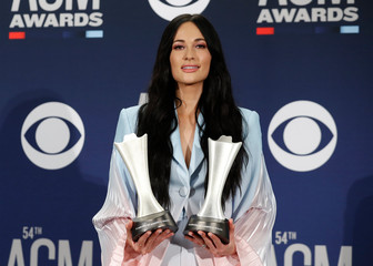 54th Academy of Country Music Awards – Photo Room – Las Vegas, Nevada, U.S., April 7, 2019 – Musgraves poses backstage with her awards for Female Artist of the Year and Album of the Year for Golden Hour