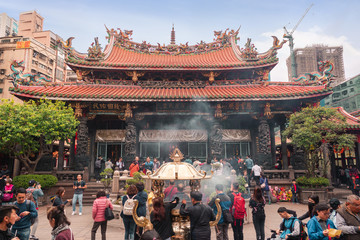 Taiwan February 28 2019.A lot of people at Longshan Buddhist temple, landmark temple in taiwan .