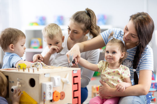 Kids play with educational toy in nursery