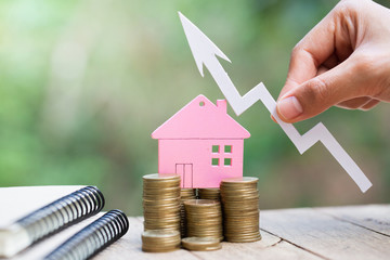 planning savings money of coins to buy a home, concept for property ladder, mortgage and real estate investment. for saving or investment for a house