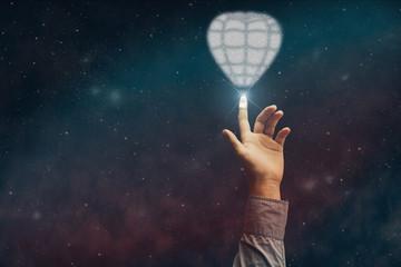 Human forefinger touches balloon innovative technologies. Mixed media.