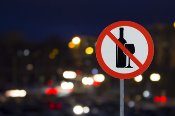 the Sign the prohibition of alcohol and the night road with cars