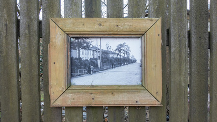 old picture in woodwn fence