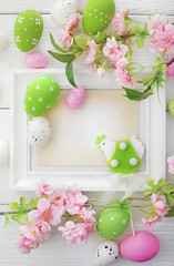 photo frame with easter eggs and cherry blossom flowers
