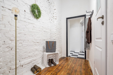 Mudroom with brick wall