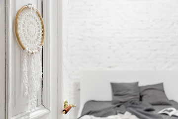 Bedroom with knitted decoration