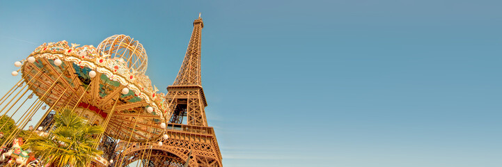 Wall Mural - Vintage carousel and the Eiffel tower, Paris France panoramic background with copy space