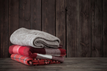 stack of plaids on wooden background