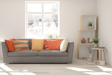 White stylish minimalist room with colorful sofa and winter landscape in window. Scandinavian interior design. 3D illustration