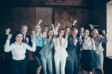 Close up photo yelling different age multiethnic mixed race business people stand she her he him his together best brigade hands arms fists raised up project got first place formalwear jackets shirts Wall mural
