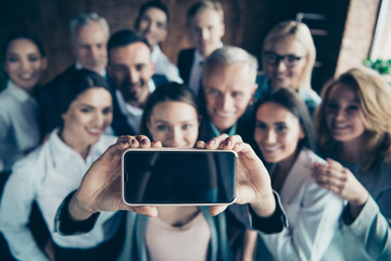 Close up blurry photo business people different age race free time excited team building hug embrace cuddle she her he him his telephone smart phone make take selfies  formal wear jackets shirts
