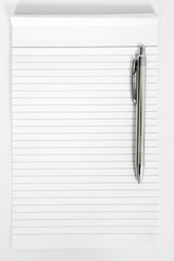 Pen on the notepad. Isolated on the white background.