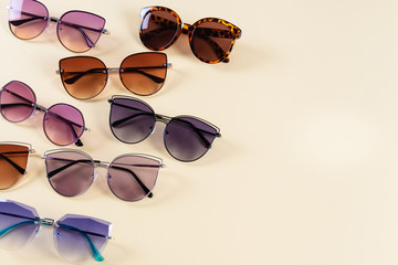 Different sunglasses on yellow background. Summer banner. Copy space. Optic shop Wall mural