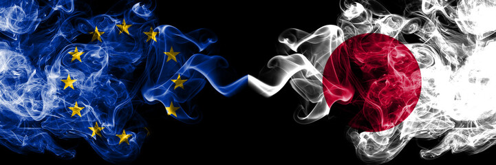 European Union vs Japan, Japanese smoke flags placed side by side. Thick colored silky smoke flags of EU and Japan, Japanese