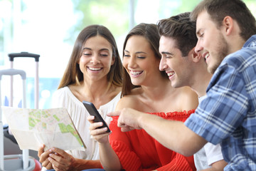 Group of tourists planning travel online on phone