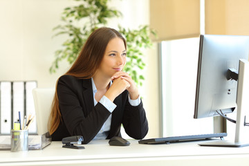 Satisfied office worker watching computer content