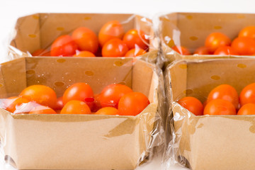 ripe cherry tomatoes packages in box and plastic