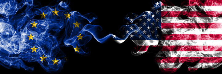 European Union vs United States of America, American smoke flags placed side by side. Thick colored silky smoke flags of EU and United States of America, American