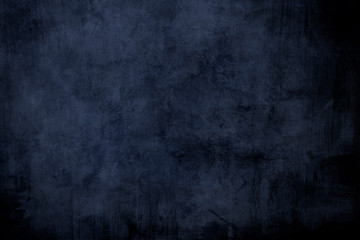 Dark blue grungy distressed canvas bacground