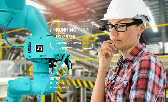 Virtual Augmented reality technology in industry 4.0. Engineer woman wearing AR glasses to see AR service,Thermal Monitoring motor for check destroy part of smart robot arm machine in smart factory.