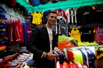 Biwar Abdullah, 25, an Iraqi Kurdish local footballer, who looks like the football player Cristiano Ronaldo, pose for a pictures at a sportswear shop in the district of Soran, northeast of Erbil