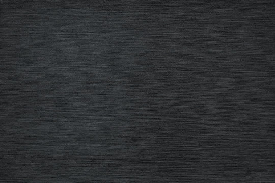 Brushed metal texture background. Stainless black steel