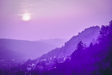 Panoramic view of hills and old town. Violet purple toned. Jena, Germany