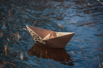 paper boat on water, craft paper, origami boat, launching boats in a lake, stream, river,.