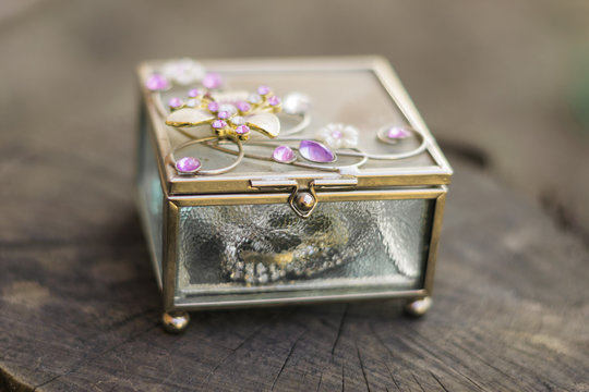 Old jewelry box with purple stones on the top