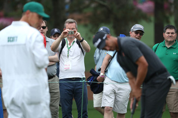 Fan takes picture during practice for the 2019 Masters golf tournament at the Augusta National Golf Club in Augusta, Georgia, U.S.