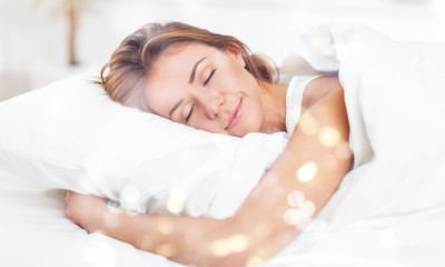 Young woman  sleeping on the white linen in bed at home Wall mural