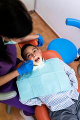 Dentist working in dental clinic