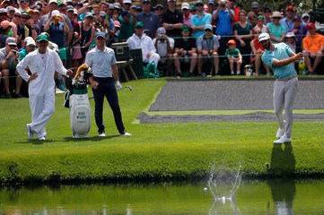 Dustin Johnson of the U.S. skips a ball across the water during practice for the 2019 Masters golf tournament at the Augusta National Golf Club in Augusta, Georgia, U.S.