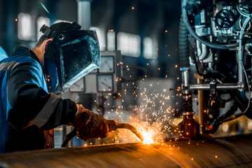 man welds at the factory Wall mural