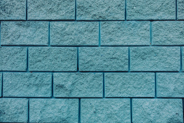 Blue brick wall background texture close up