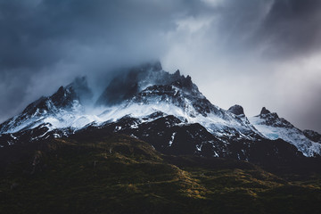 Patagonia snow capped mountains in a stormy atmosphere