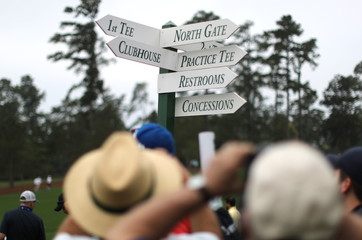Patrons take pictures of one of the the direction signs during practice for the 2019 Masters golf tournament at the Augusta National Golf Club in Augusta, Georgia, U.S.