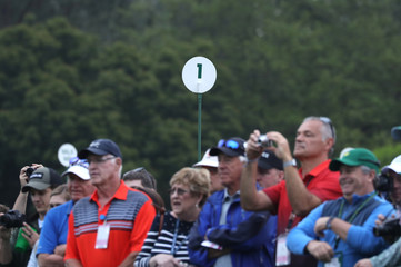 Patrons take pictures at the first hole during practice for the 2019 Masters golf tournament at the Augusta National Golf Club in Augusta, Georgia, U.S.