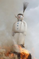 The Boeoegg, a snowman made of wadding and filled with firecrackers, is burning in a bonfire in the Sechselaeuten square in Zurich