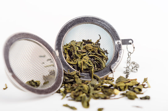 Green tea in a metal strainer. Concept natural tasty healthy drink.